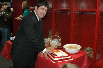Nathan cuts the cake in honor of 1999 State Champs | Augusta Christian Schools